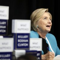 """Hillary Rodham Clinton signs copies of her book """"What Happened"""" at a book store in New York, Tuesday, Sept. 12, 2017. (Seth Wenig/AP)"""