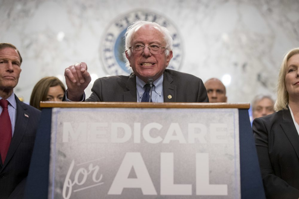 Sen. Bernie Sanders, I-Vt., center, accompanied by Sen. Richard Blumenthal, D-Conn., left, and Sen. Kirsten Gillibrand, D-N.Y., right, speaks at a news conference on Capitol Hill in Washington, Wednesday, Sept. 13, 2017, to unveil their Medicare for All legislation to reform health care. (Andrew Harnik/AP)