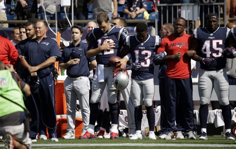 Patriots head coach Bill Belichick, left, and Tom Brady (12), Phillip Dorsett (13), Matthew Slater, second from right, and David Harris (45) stand during the national anthem before Sunday's game against the Texans. (Steven Senne/AP)