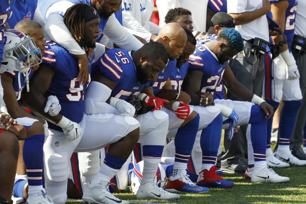 Buffalo Bills players take a knee during the national anthem prior to an NFL football game against the Denver Broncos, Sunday, Sept. 24, 2017, in Orchard Park, N.Y. (Jeffrey T. Barnes/AP)