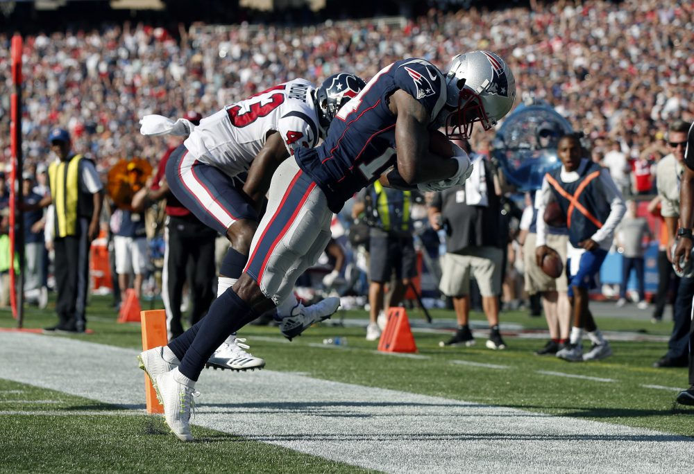 Patriots wide receiver Brandin Cooks drags his toes as he makes the game-winning catch in the end zone for a touchdown in front of Houston Texans safety Corey Moore, Sunday in Foxborough. The Patriots won 36-33. (Michael Dwyer/AP)