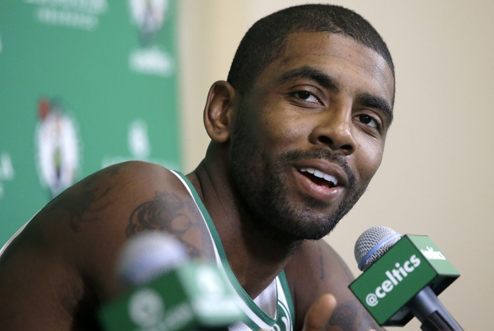 Boston Celtics' Kyrie Irving takes questions from reporters at media day, Monday in Canton, Mass. (Steven Senne/AP)