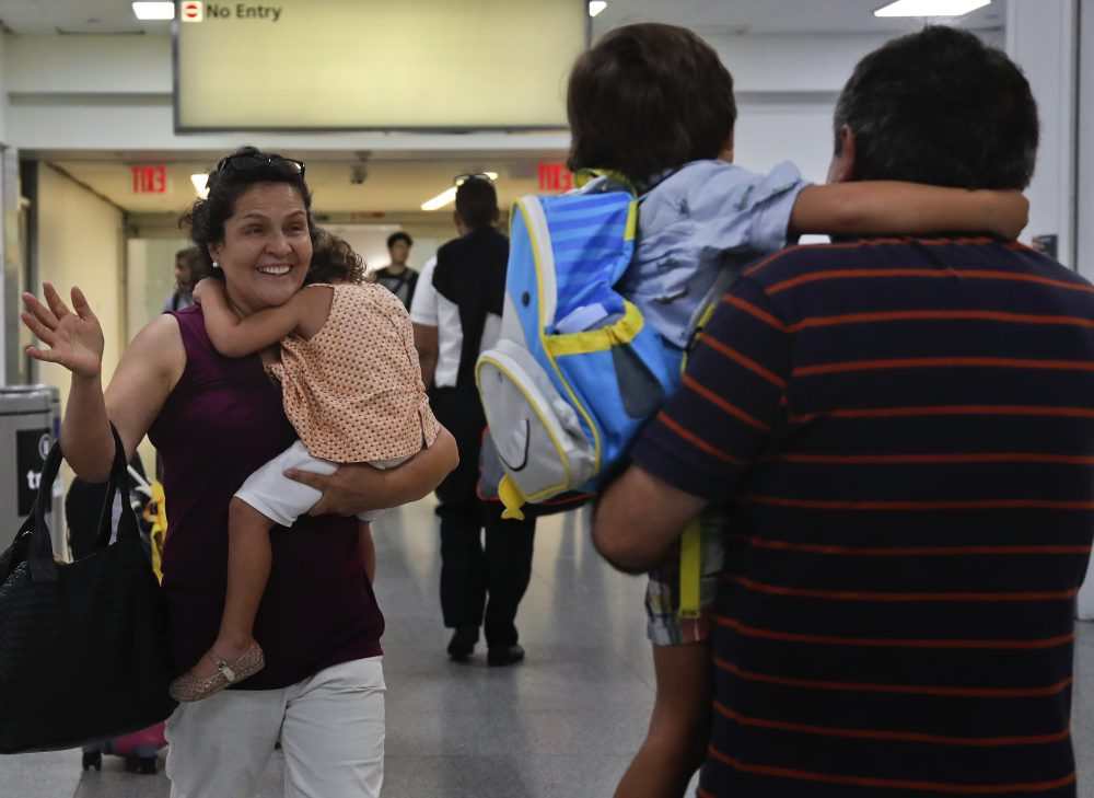 Elena Rojas, left, of Queens, N.Y., reacts as she greets her 4-year-old grandson Elias while carrying her 3-year-old granddaughter Lilly after the children arrived at JFK Airport Tuesday from Puerto Rico with their mother Cori Rojas (not pictured). Cori Rojas and her children fled Puerto Rico after Hurricane Maria devastated the island and will stay in Queens. (Julie Jacobson/AP)