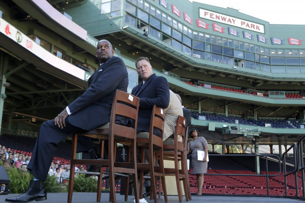 "Cedric Maxwell, former Boston Celtics player and Bob Sweeney, executive director of the Boston Bruins Foundation, look toward a video screen during a panel discussion held to introduce an initiative called ""Take The Lead"" Thursday at Fenway Park. (Steven Senne/AP)"