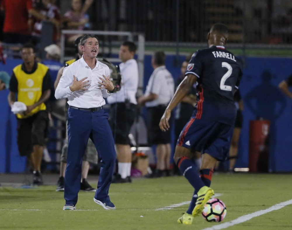 New England Revolution coach Jay Heaps signals to defender Andrew Farrell during the first half of the U.S. Open Cup soccer final against FC Dallas in 2016. (Tony Gutierrez/AP)