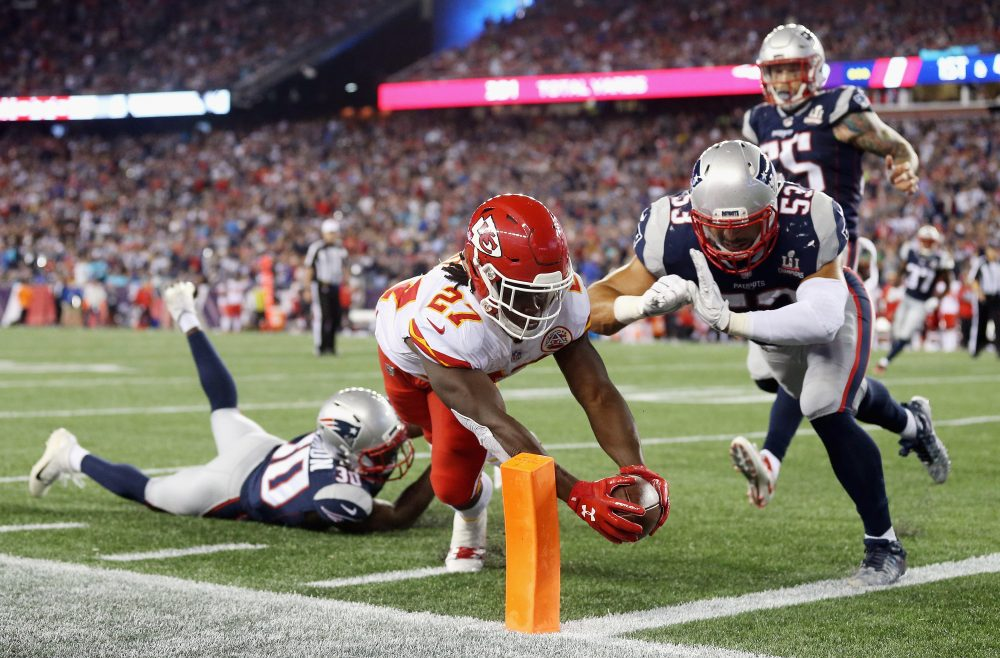 Kareem Hunt of the Kansas City Chiefs scores the third of his three touchdowns during the Chiefs' surprising win against the defending Super Bowl Champs.  (Maddie Meyer/Getty Images)