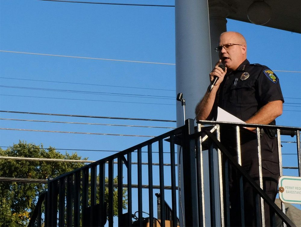 Claremont Police Chief Mark Chase speaks during the vigil. (Britta Greene/NHPR)