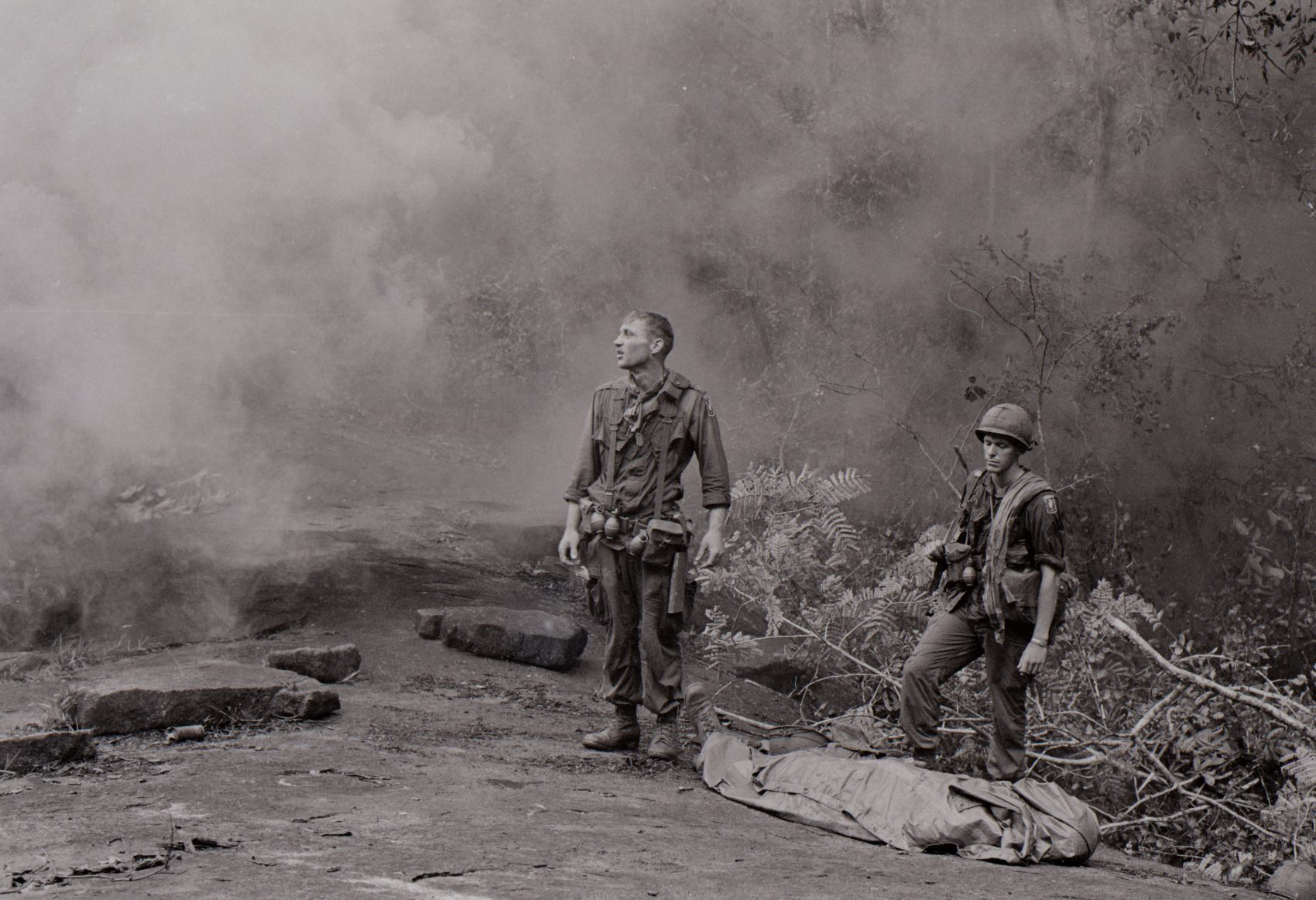 Long Khanh Province, Republic of Vietnam: SP4 R. Richter, 4th Battalion, 503rd Infantry, 173rd Airborne Brigade, lifts his battle weary eyes to the heavens, as if to ask why? Sergeant Daniel E. Spencer stares down at their fallen comrade. The day's battle ended, the silently await the helicopter which will evacuate their comrade from the jungle covered hills. (Courtesy of National Archives and Records Administration)
