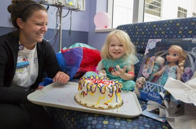Child life specialist Kelly Boyd, left, at Willow's third birthday party during Hurricane Irma (Courtesy of Johns Hopkins All Children's Hospital)