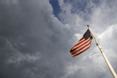 An American flag flaps in the wind in Denver. (David Zalubowski/AP)