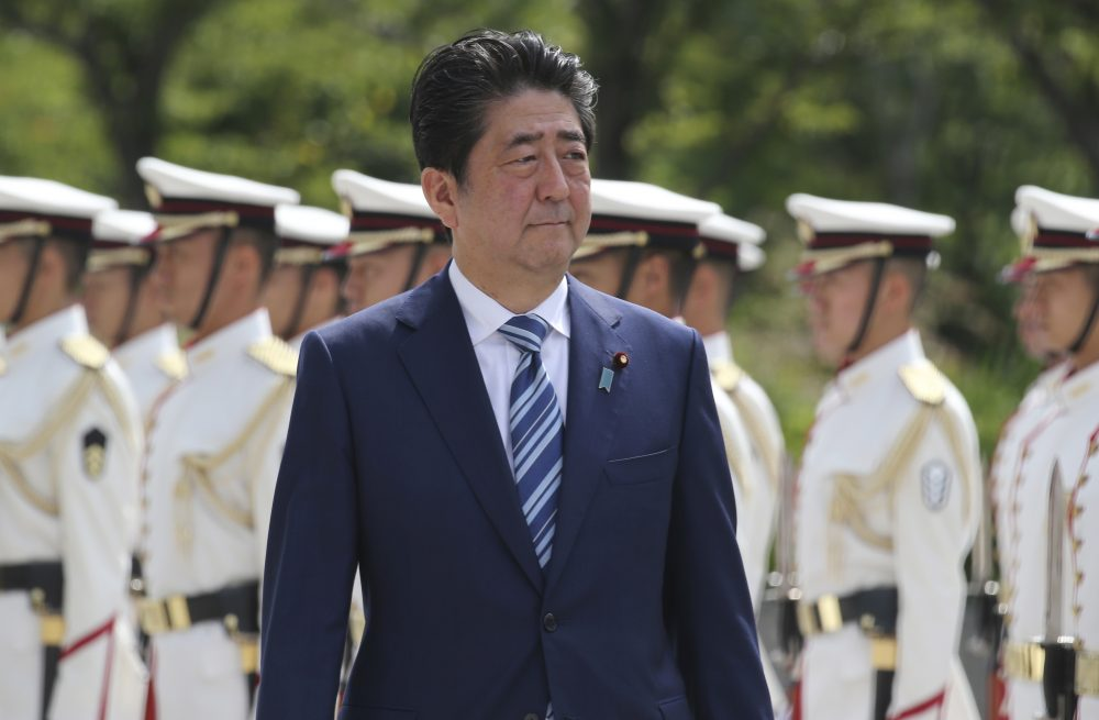 Japanese Prime Minister Shinzo Abe inspects an honor guard during the Japan Self-Defense Forces senior officers' gathering at Defense Ministry in Tokyo. (Koji Sasahara/AP)