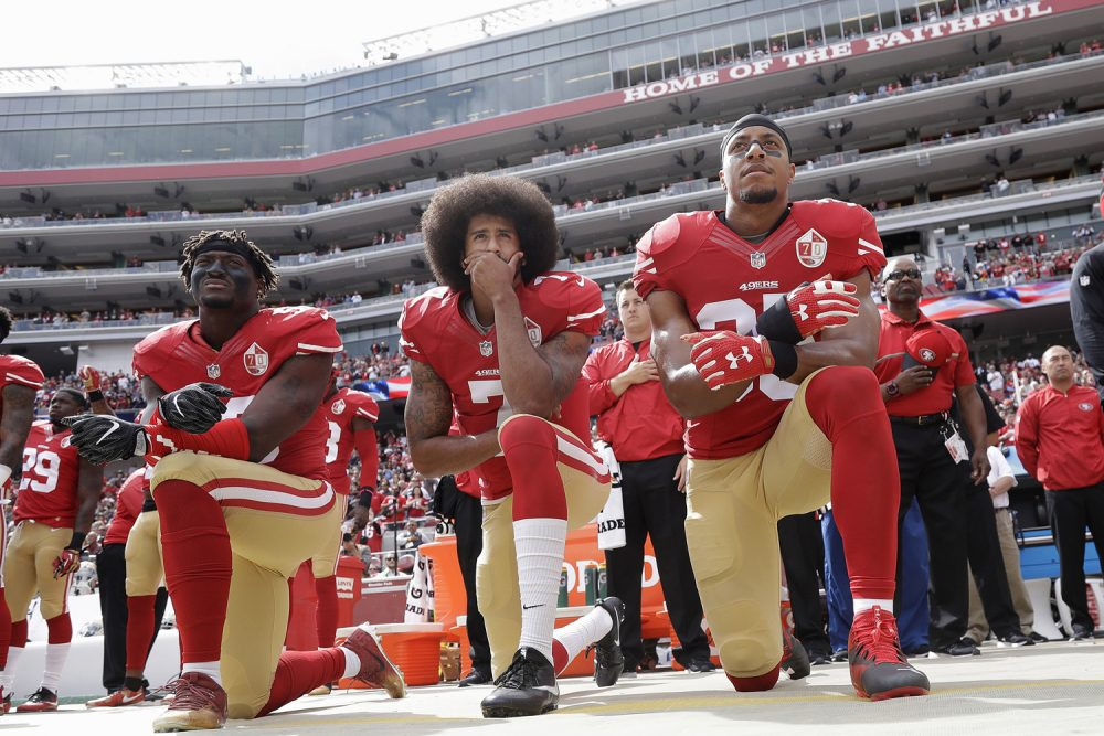 In this Oct. 2, 2016 file photo, from left, San Francisco 49ers outside linebacker Eli Harold, quarterback Colin Kaepernick and safety Eric Reid kneel in protest during the national anthem before an NFL football game against the Dallas Cowboys in Santa Clara, Calif. (Marcio Jose Sanchez, AP)