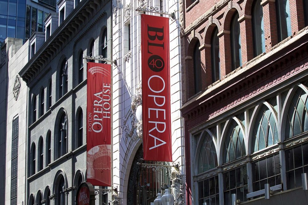 Banners for the Boston Lyric Opera's 40th anniversary hang outside the Boston Opera House in 2016. (Jesse Costa/WBUR)