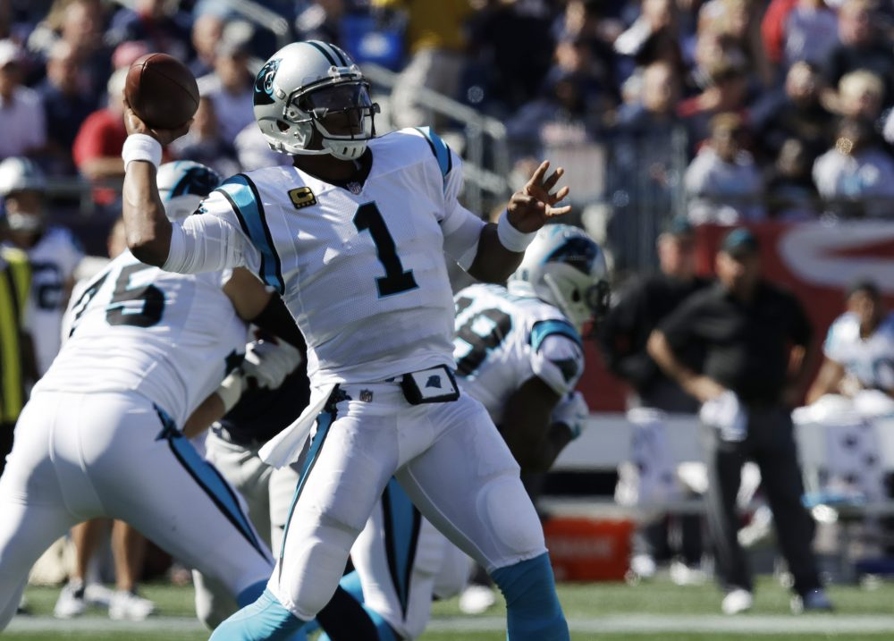 Carolina Panthers quarterback Cam Newton (1) passes during the first half on Sunday in Foxborough, Mass. (Charles Krupa/AP)
