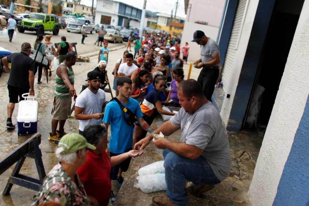 Hundreds of people line up to buy ice at a local plant in the aftermath of Hurricane Maria, in Arecibo, Puerto Rico, Sept. 30, 2017. (Ricardo Arduengo/AFP/Getty Images)