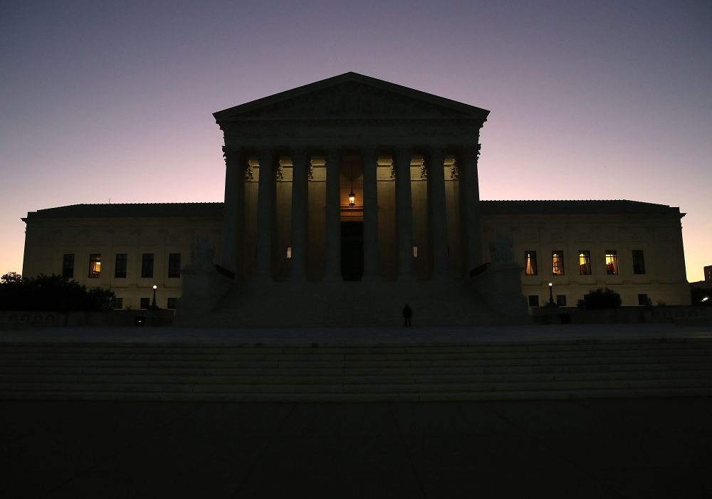 The sun begins to rise behind the U.S. Supreme Court, on Oct. 2, 2017, in Washington, D.C. This session the high court will hear several cases including Wisconsin redistricting and the case of the Colorado baker who refused to make a wedding cake for a gay couple. (Mark Wilson/Getty Images)