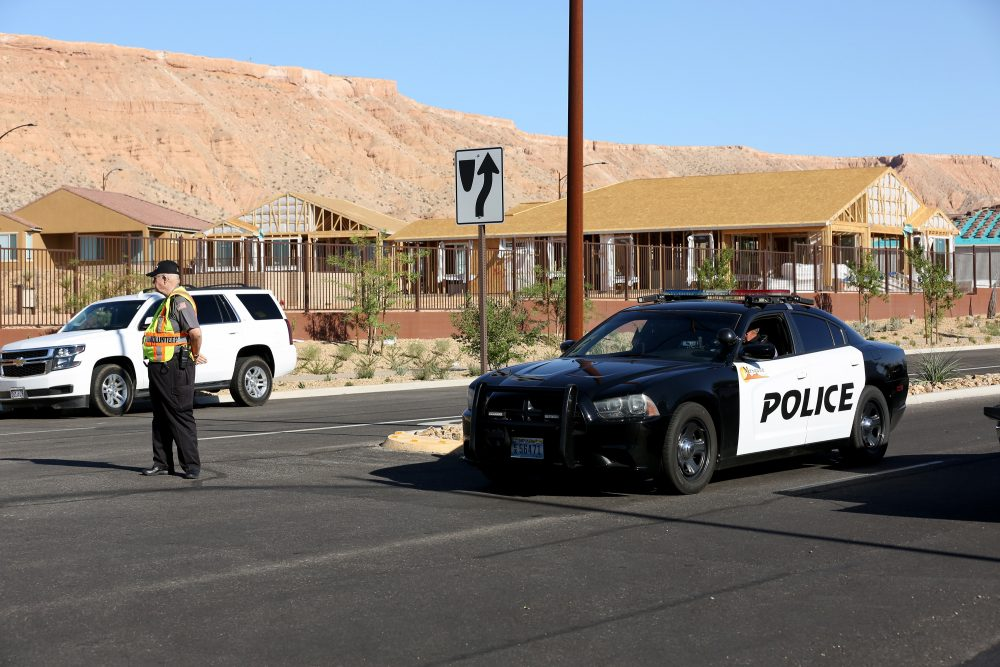 A Mesquite Police Department citizen volunteer and a Mesquite Police car block access to the Sun City Mesquite community where suspected Las Vegas gunman Stephen Padock lived on Oct. 2, 2017, in Mesquite, Nev. (Gabe Ginsberg/Getty Images)