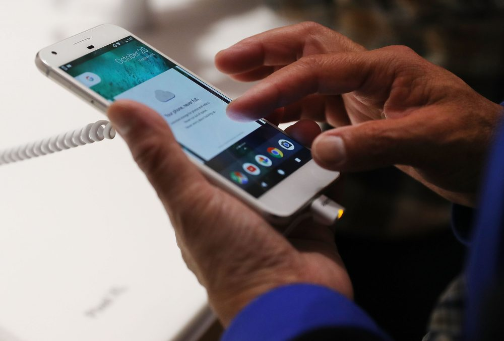 A person tries a Google Pixel phone at the Google pop-up shop in the SoHo neighborhood on Oct. 20, 2016 in New York City. (Spencer Platt/Getty Images)