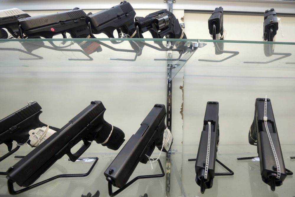 This Wednesday, June 29, 2016, photo shows guns on display at a gun store in Miami.  (Alan Diaz/AP)