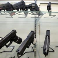 This Wednesday, June 29, 2016, photo shows guns on display at a gun store in Miami.  (Alan Diaz/AP)