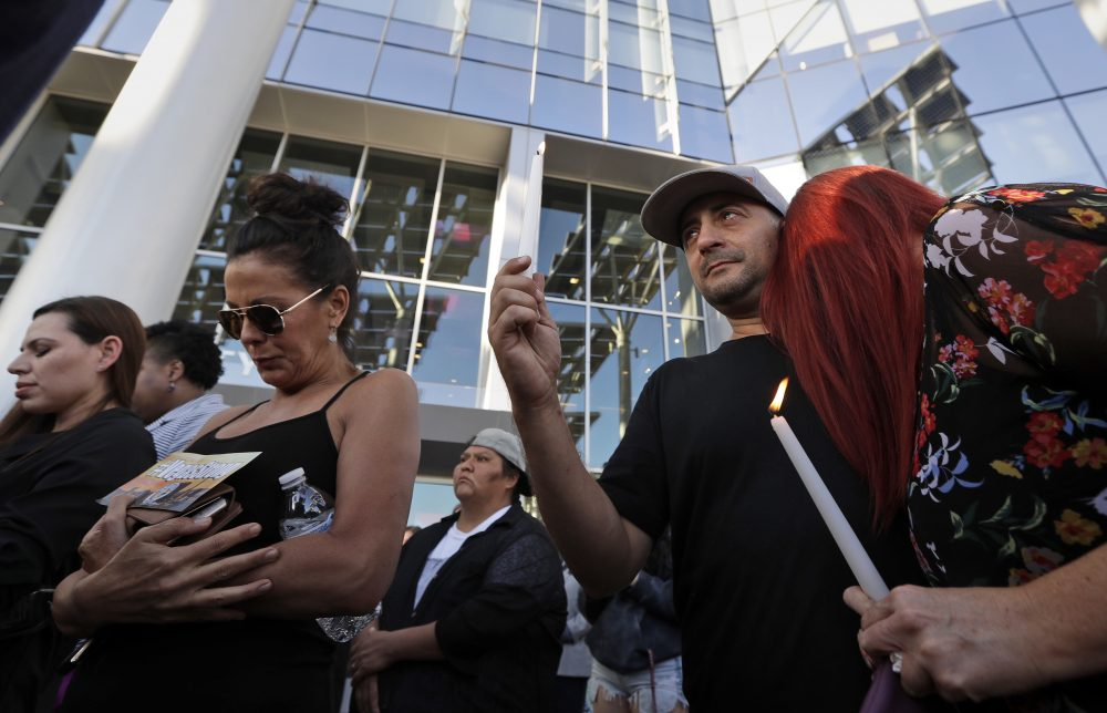 Joe Thomas hugs Elizabeth Reitz, right, during a vigil at City Hall in Las Vegas, Monday, Oct. 2, 2017. The vigil was held in honor of the over 50 people killed and hundreds injured in a mass shooting at an outdoor music concert late Sunday. (Gregory Bull/AP)