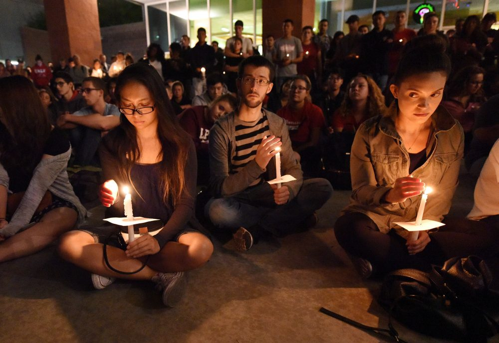 People attend a candlelight vigil at the University of Nevada Las Vegas student union Oct. 2, 2017. (Robyn Beck/AFP/Getty Images)