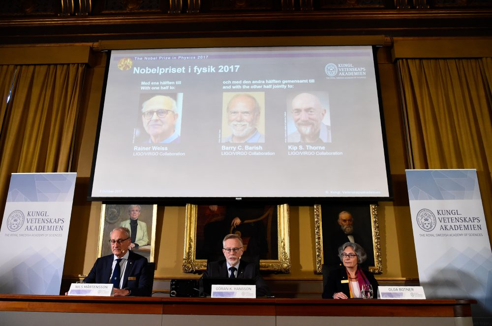 Nobel Committee for Physics members (bottom, left to right) chairman, professor Nils Martensson, Goran K. Hansson, secretary general of the Royal Swedish Academy of Sciences and Olga Botner, professor of experimental elementary particle physics, announce the 2017 winner of the Nobel Prize in Physics on Oct. 3, 2017, at the Royal Swedish Academy of Sciences in Stockholm. 2017 laureates for the Nobel Prize in Physics (on the display, left to right) are Rainer Weiss, Barry C. Barish and Kip S. Thorne. (Jonathan Nackstrand/AFP/Getty Images)