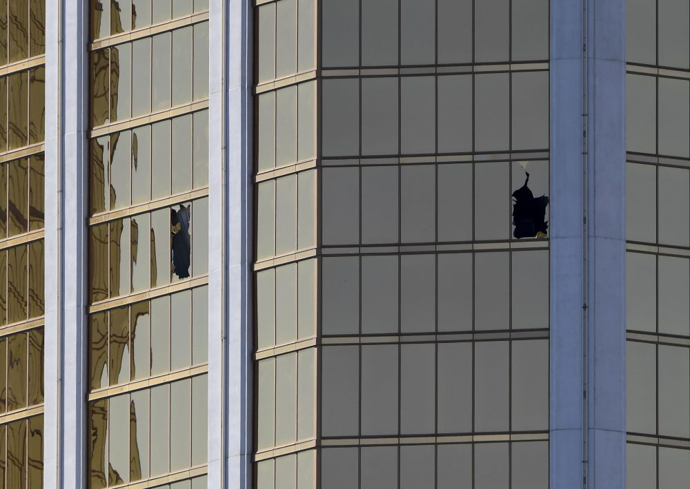 The damaged windows on the 32nd-floor room that was used by the shooter in the Mandalay Hotel after a gunman killed at least 59 people and wounded more than 500 others when he opened fire on a country music concert in Las Vegas on Oct. 2, 2017. (Mark Ralston/AFP/Getty Images)