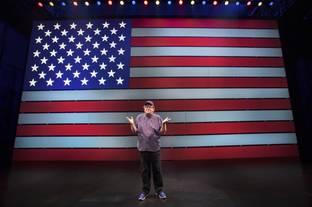 """Michael Moore onstage in """"The Terms of My Surrender."""" (Courtesy Joan Marcus)"""