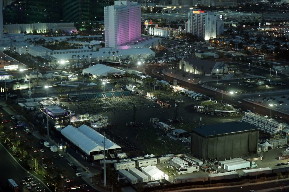 The festival grounds across the street from the Mandalay Bay resort and casino, where a mass shooting occurred, is seen at nighttime Tuesday, Oct. 3, 2017, in Las Vegas. Authorities said Stephen Craig Paddock broke windows at the resort and began firing with a cache of weapons Sunday, killing dozens and injuring hundreds at a music festival. (Marcio Jose Sanchez/AP)