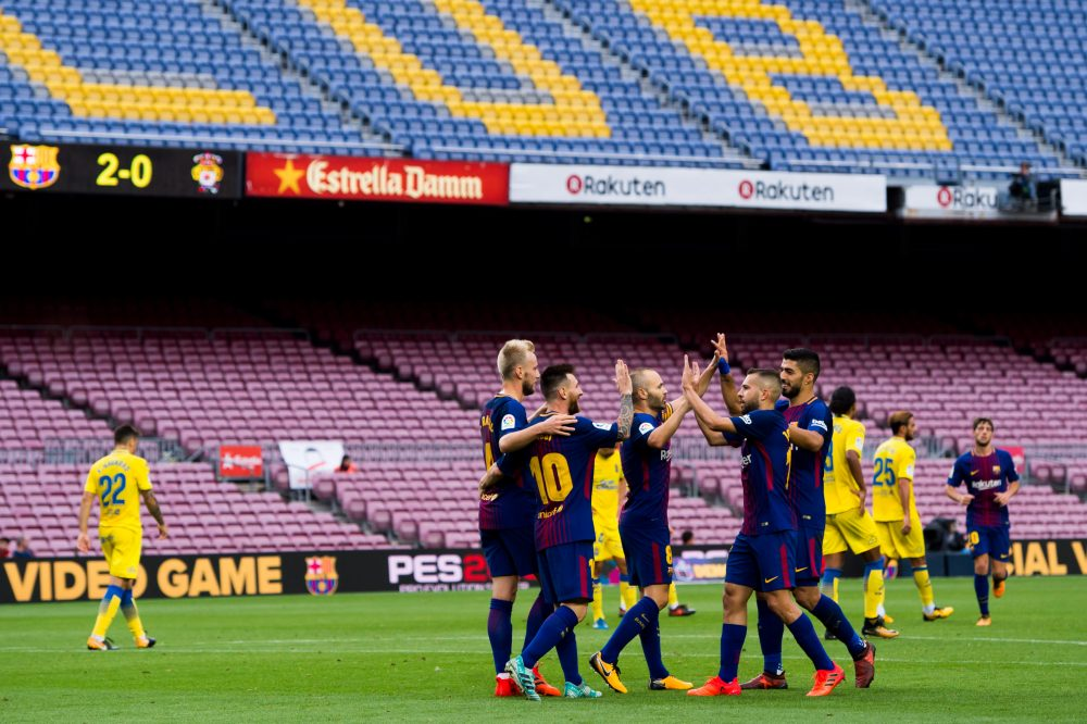 FC Barcelona celebrates in front of empty stands during their match with Las Palmas. (Alex Caparros/Getty Images)
