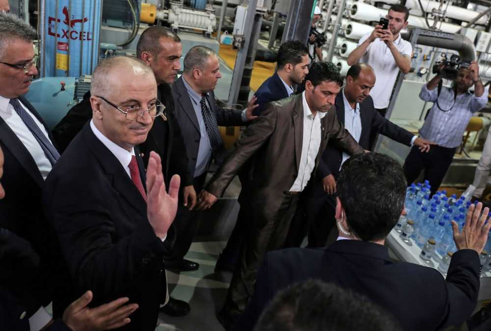 Palestinian Prime Minister Rami Hamdallah (left) visits a water desalination plant in Deir el-Balah in central Gaza on Oct. 5, 2017. (Said Khatib/AFP/Getty Images)