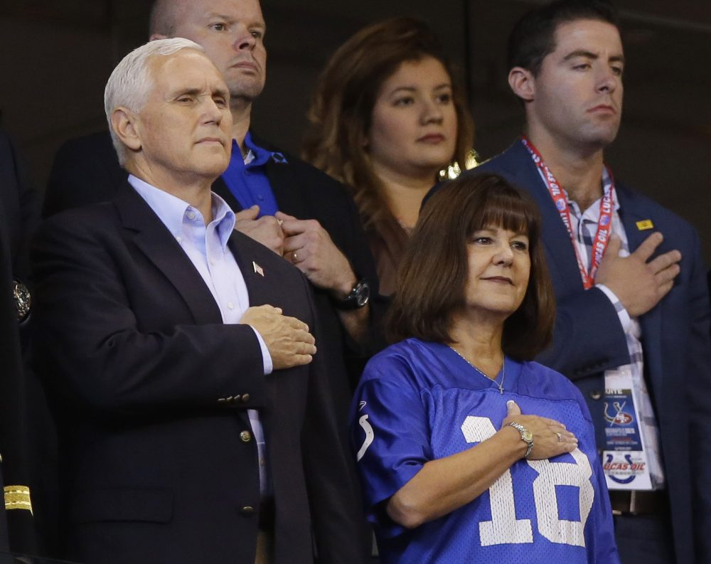 Vice President Mike Pence and his wife, Karen, stand during the playing of the national anthem before an NFL football game between the Indianapolis Colts and the San Francisco 49ers, Sunday, Oct. 8, 2017, in Indianapolis. (Michael Conroy/AP)