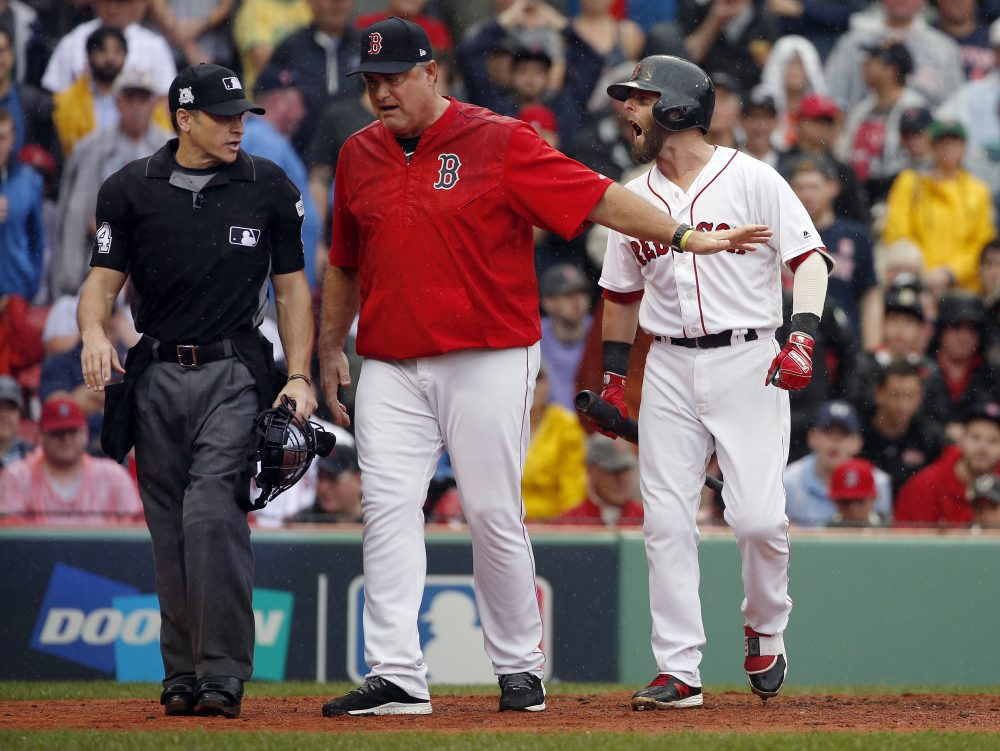 Red Sox manager John Farrell is ejected after defending Dustin Pedroia, who was called out on strikes in a Game 4 loss to the Houston Astros. (Michael Dwyer/AP)