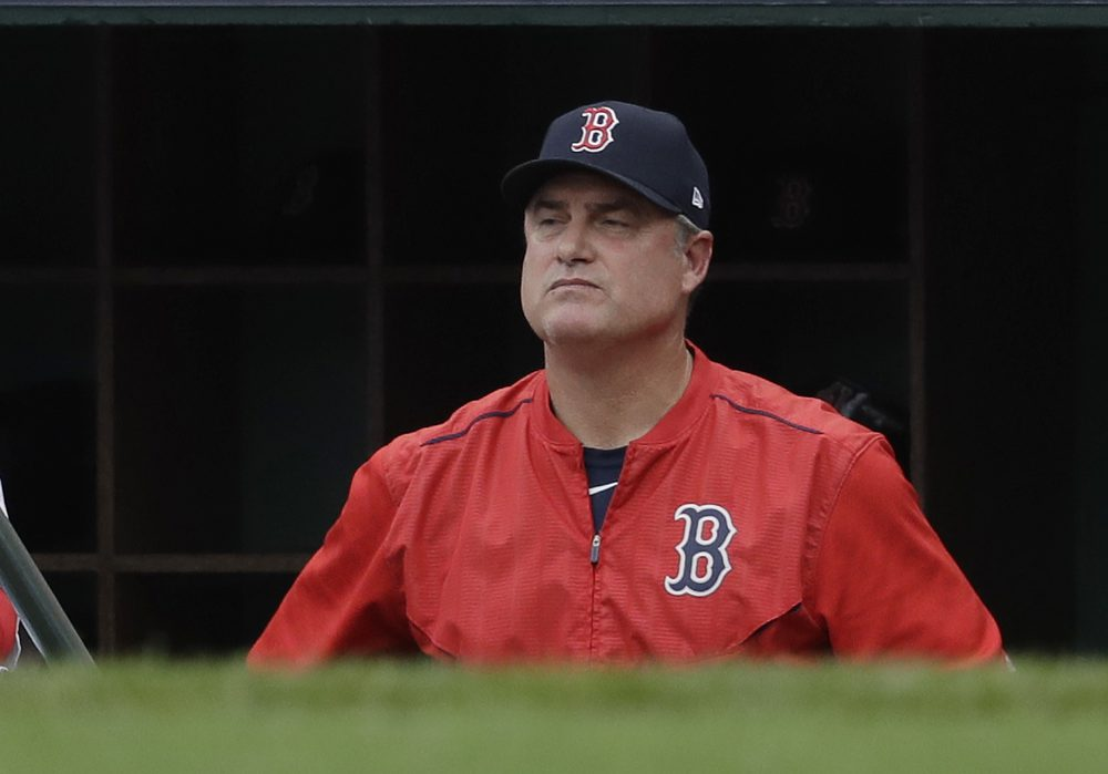 Boston Red Sox manager John Farrell watches from the dugout during the second inning in Game 3 of baseball's American League Division Series against the Houston Astros on Sunday. (Charles Krupa/AP)