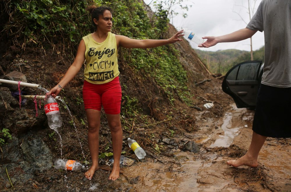 Yanira Rios collects spring water for her house nearly three weeks after Hurricane Maria hit Puerto Rico, on Oct. 10, 2017 in Utuado, Puerto Rico. Her house and most of the municipality is without running water or grid power. (Mario Tama/Getty Images)