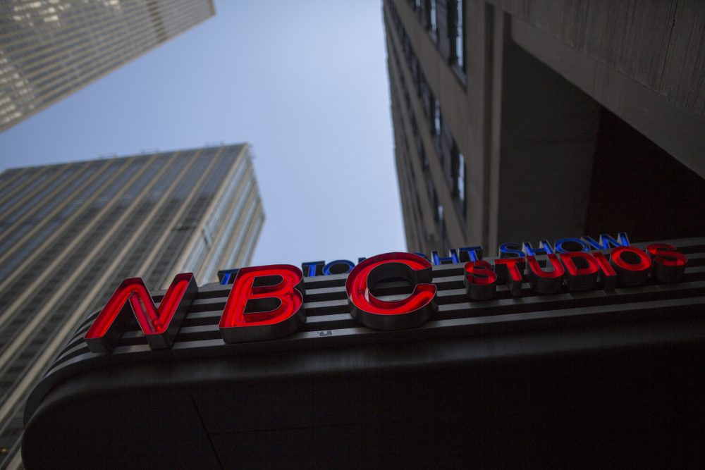 This Wednesday, May 10, 2017, file photo, shows the NBC logo at their television studios at Rockefeller Center in New York. On Wednesday, Oct. 11, 2017, President Trump threatened NBC's broadcast licenses because he's not happy with how its news division has covered him. But experts say it's not likely his threats would lead to any action against the company. (Mary Altaffer/AP)