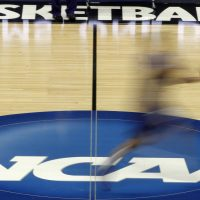 Should college athletes be paid? The majority of blacks in the U.S. think they should. The majority of whites do not. (Keith Srakocic/AP)