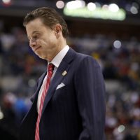 Louisville removed men's basketball head coach Rick Pitino from his position amid FBI investigation into corruption, bribery and fraud in the NCAA. (Jeff Roberson/AP)