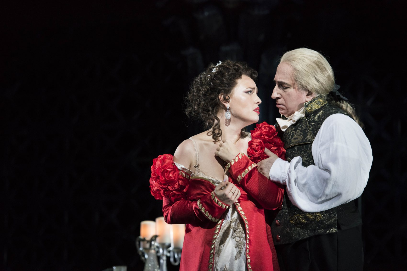 "Tosca, portrayed by Elena Stikhina, submits to Scarpia, played by Daniel Sutin, to save the life of her true love in the Boston Lyric Opera production of ""Tosca."" (Courtesy Liza Voll/Boston Lyric Opera)"