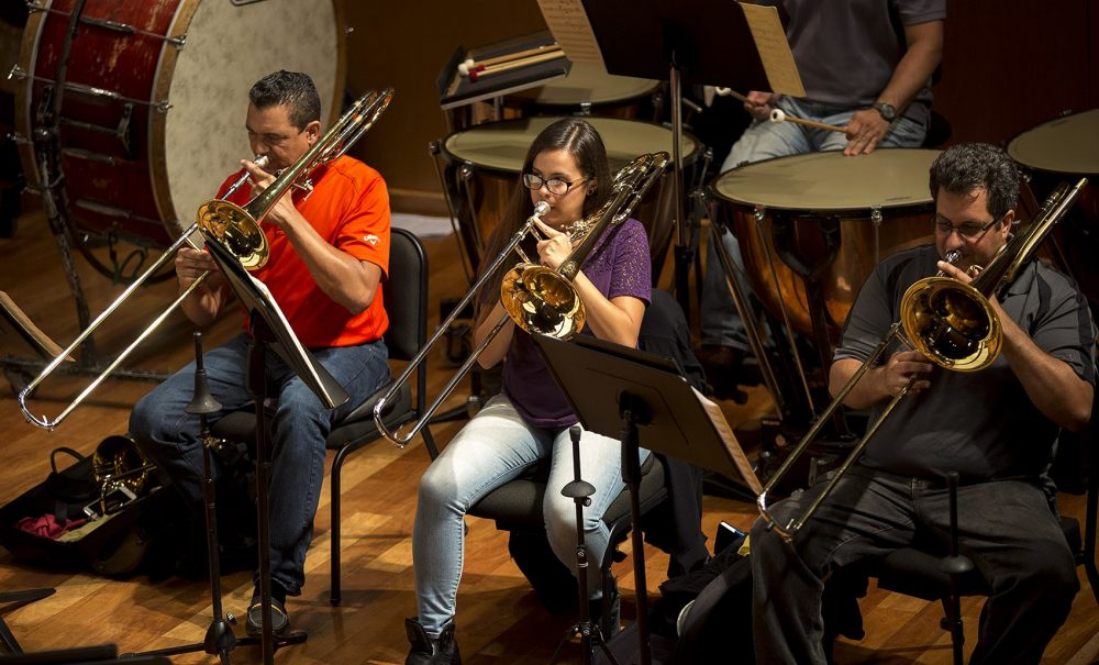 The trombone section of the Puerto Rico Symphony Orchestra during a rehearsal before a string of free concerts. (Jesse Costa/WBUR)