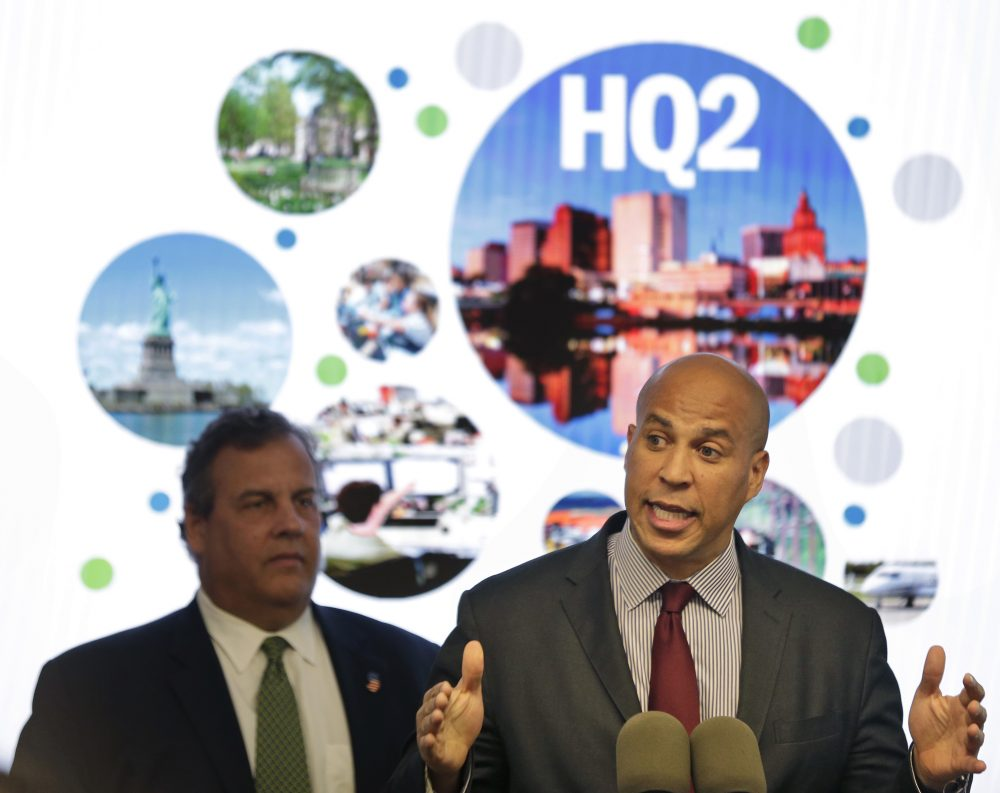New Jersey Sen. Cory Booker, right, speaks while New Jersey Gov. Chris Christie stands behind him during an announcement in Newark, N.J., Monday, Oct. 16, 2017. The New Jersey lawmakers announced they are submitting a bid to Amazon that Newark would be the best location for their planned second headquarters. (Seth Wenig/AP)