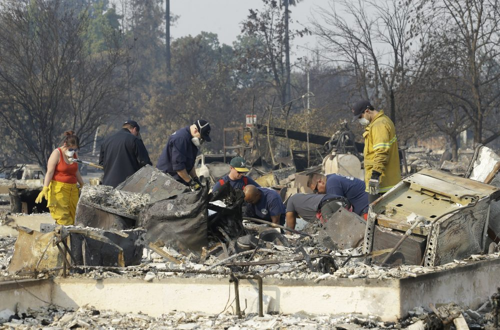 Authorities sift through the burned area of a home as they search for victims at Coffey Park area of Santa Rosa, Calif., Monday, Oct. 16, 2017. (Rich Pedroncelli/AP)