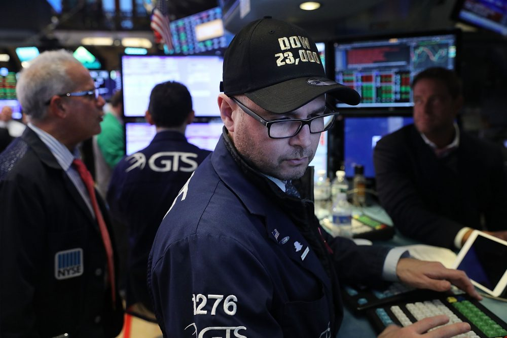 A trader wears a hat reading Dow 23,000 on the floor of the New York Stock Exchange (NYSE) on Oct. 17, 2017 in New York City. (Spencer Platt/Getty Images)