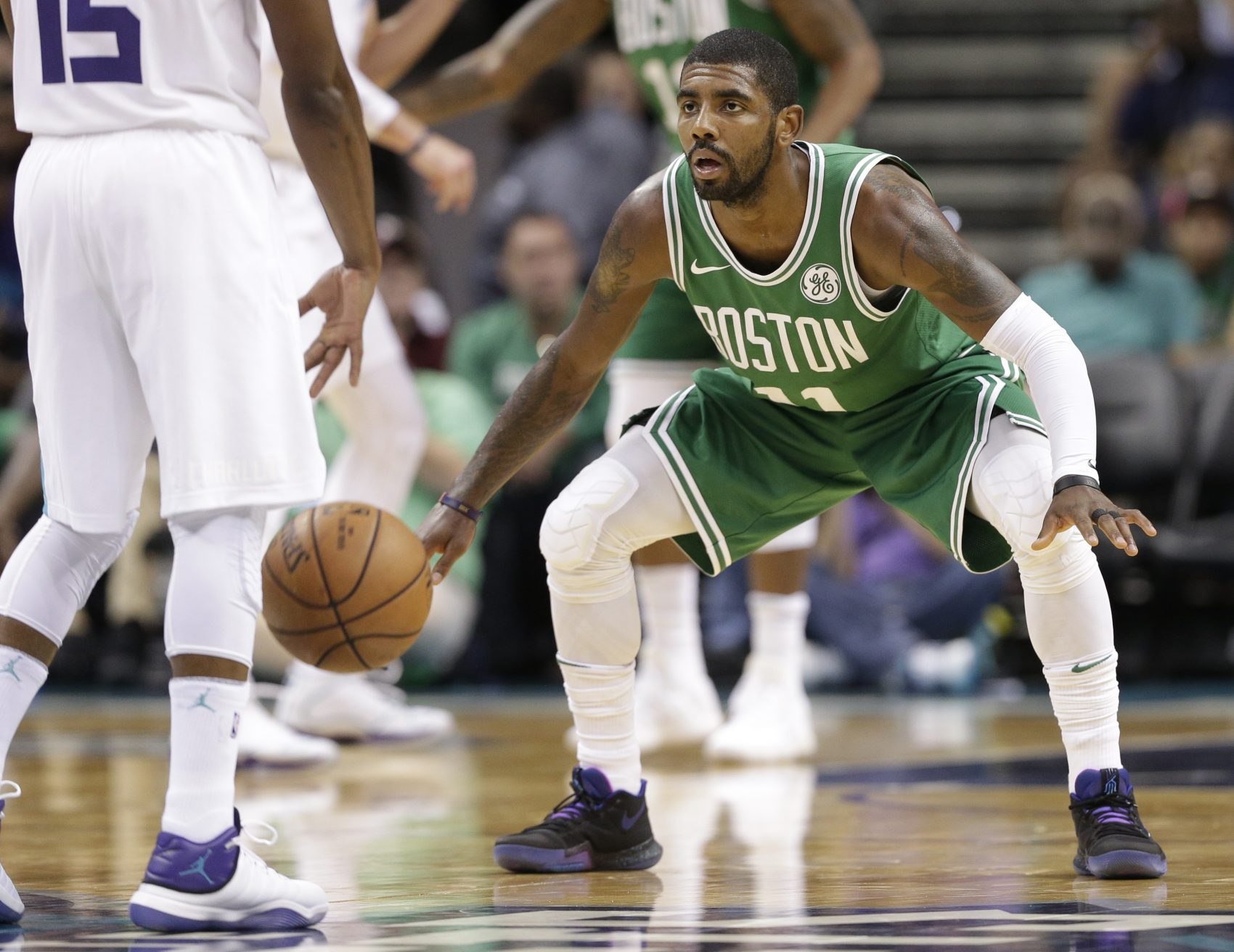 the latest de397 66c69 Boston Celtics  Kyrie Irving guards Charlotte Hornets  Kemba Walker in the  first half.