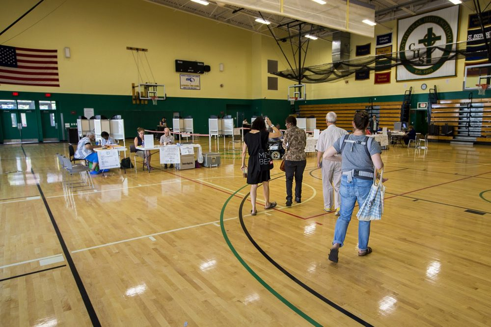 Voting was light around the city during this September's preliminary election. Here a few stragglers walk into the voting area at the Cathedral High School in the South End. (Jesse Costa/WBUR)