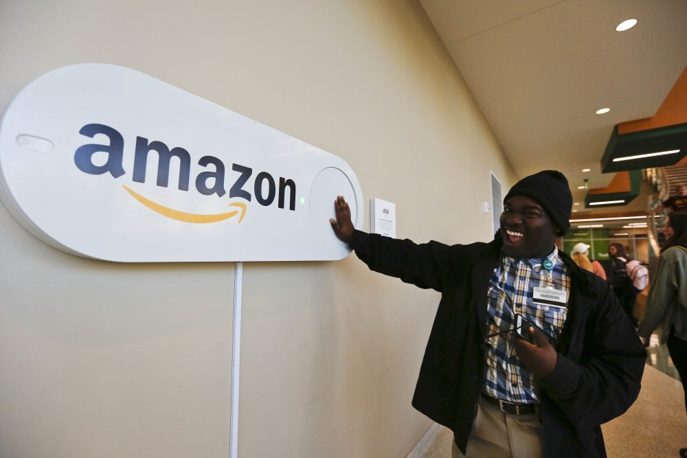 In this Monday, Oct. 16, 2017, photo, Zavian Tate, a student at the University of Alabama at Birmingham, pushes a large Amazon Dash button, in Birmingham, Ala. The large Dash buttons are part of the city's campaign to lure Amazon's second headquarters to Birmingham. (Brynn Anderson/AP)