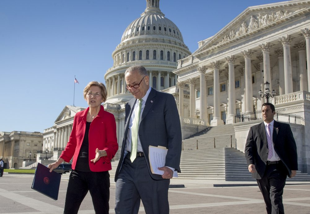 Sen. Elizabeth Warren, D-Mass., left, and Senate Minority Leader Chuck Schumer, D-N.Y., walk to a news conference on the Republican tax and budget proposals, at the Capitol in Washington, Wednesday, Oct. 18, 2017. (J. Scott Applewhite/AP)