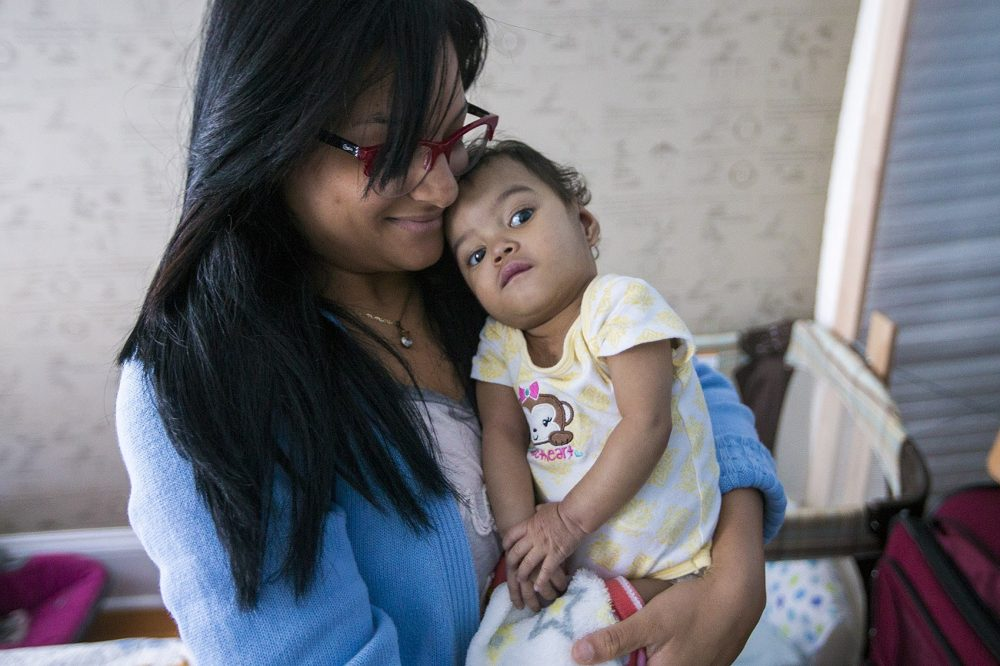 Alianette Andino and her 14-month-old daughter, Amaia, are in Boston to get an appointment at Children's Hospital to deal with a rare heart condition Amaia has. (Jesse Costa/WBUR)