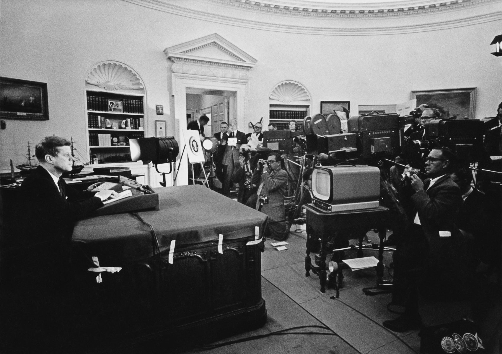 President John F. Kennedy announces on television the strategic blockade of Cuba, and his warning to the Soviet Union about missile sanctions during the Cuban missile crisis, on Oct. 22, 1962. (Keystone/Getty Images)